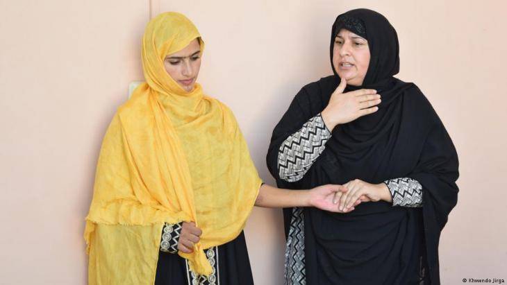 Tabassum Aadnan (right) talks to a younger woman in the jirga (photo: Khwendo Jirga)
