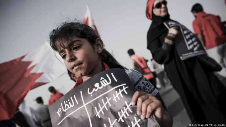 A young girl in A′ali, Bahrain, attends an anti-government demonstration (photo: Mohammed Al-Shaikh/AFP/Getty Images)