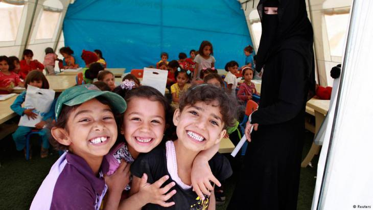 Syrian refugee children attend school in a UN tent in the Zaatari refugee camp, Jordan (photo: Reuters)