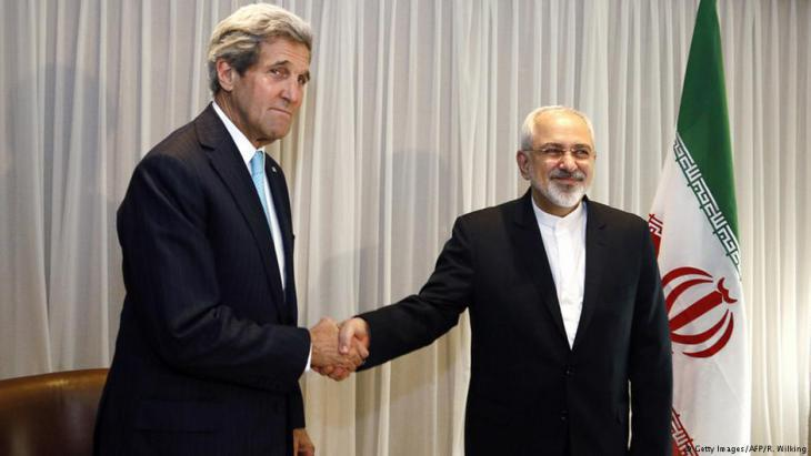 US Secretary of State John Kerry (left) shakes hands with Iranian Foreign Minister Mohammad Javad Zarif, Geneva, 14 January 2015 (photo: Rick Wilking/AFP/Getty Images)