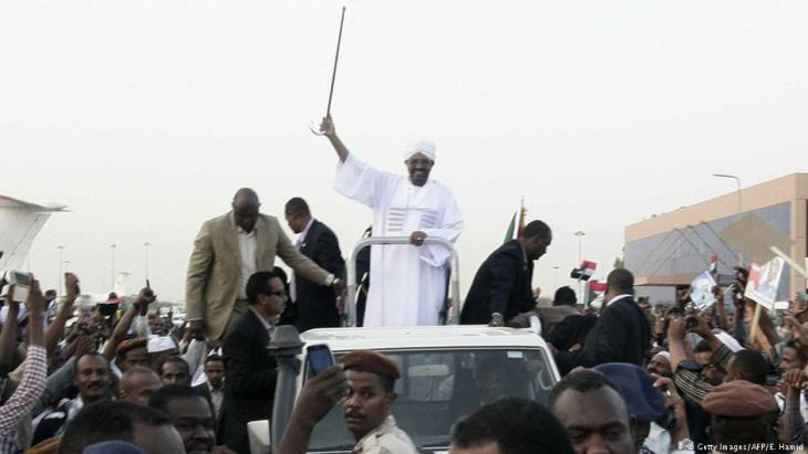 Omar al-Bashir celebrating in Khartoum upon his return from the African Union (AU) summit in Johannesburg (photo: AFP/Getty Images)