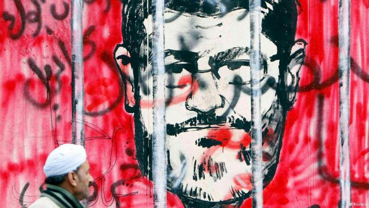 Graffiti in Cairo showing former Egyptian President Mohammed Morsi behind bars (photo: Reuters)