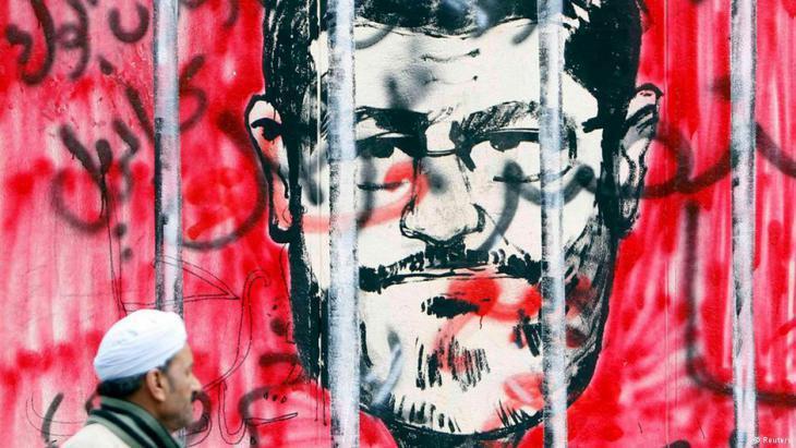 Graffiti in Cairo showing former Egyptian President Mohammed Morsi behind bars (photo: Reuters)
