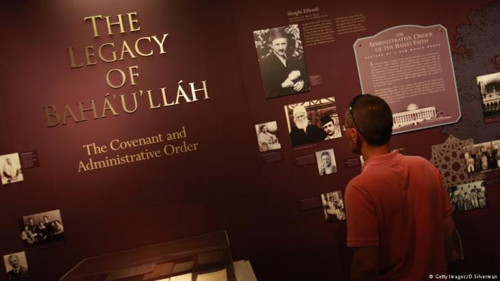 A visitor to an exhibition in Haifa about the founder of the Baha'i religion, Baha'u'llah (photo: Getty images)