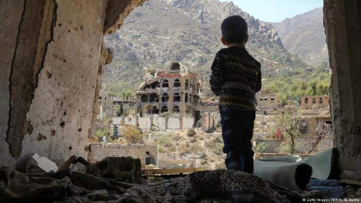 Child standing in the ruins of Taiz, Yemen (photo: Getty Images/AFP)