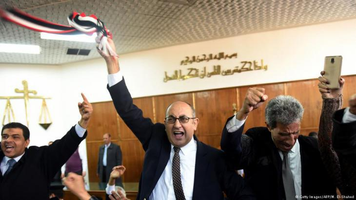 Khaled Ali celebrates his legal victory over President Sisi in a Cairo courtroom (photo: AFP/Getty Images)