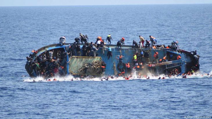 Capsizing refugee boat in the Mediterranean (photo: Reuters)