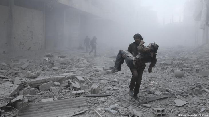 Rescuing injured civilians following a government airstrike on Eastern Ghouta (photo: Getty Images/AFP)