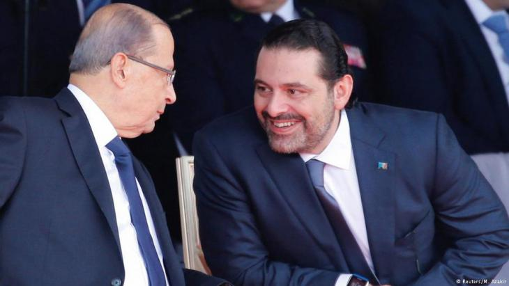 Saad Hariri, who announced his resignation as Lebanon's prime minister from Saudi Arabia reacts as he talks with Lebanese President Michel Aoun while attending a military parade to celebrate the 74th anniversary of Lebanon's independence in downtown Beirut, Lebanon 22 November 2017 (photo: Reuters/Mohamed Azakir)