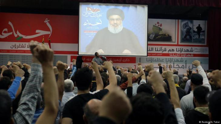 Lebanon's Hezbollah leader Sayyed Hassan Nasrallah is seen on a video screen as he addresses his supporters in Beirut, 10 November 2017 (photo: Reuters/Aziz Taher)