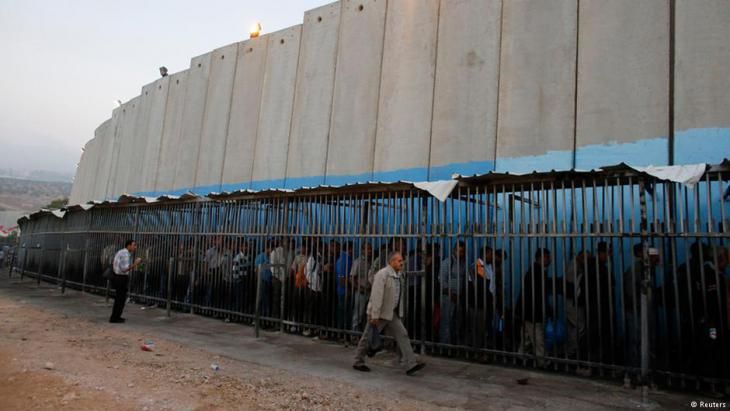 Palestinians wait to pass an Israeli checkpoint at the Palestinian town of Bethlehem on the West Bank (photo: Reuters)