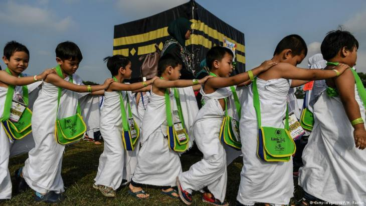 Ihram-clad Malaysian Muslim boys from the Little Caliphs kindergarten circumambulate a mockup of the Kaaba, Islam's most sacred structure located in the holy city of Mecca, during an educational simulation of the Hajj pilgrimage in Shah Alam, outside Kuala Lumpur on 24 July 2017 (photo: MOHD RASFAN/AFP/Getty Images)