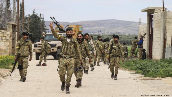 "Free Syrian Army members patrol as Turkish Armed Forces and Free Syrian Army (FSA) liberate 16 more villages and a strategic mountain within the ""Operation Olive Branch"" and deployed forces only 1.5 kilometres away from the town of Afrin in Syria on 12 March 2018 (photo: picture-alliance /AA/H. Al Homsi)"