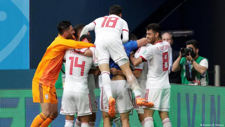 Iranian team members celebrate an unexpected victory (photo: Reuters)