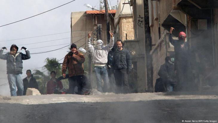 Anti-government protesters gesture on the streets of Daraa, 100 km south of the capital Damascus on 23 March 2011 (photo: Anwar Amro/AFP/Getty Images)