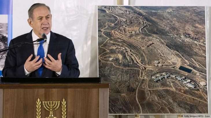 Israeli Prime Minister Benjamin Netanyahu delivers a speech during a memorial ceremony for Ron Nahman, the founder of Ariel, one of the largest Israeli settlements in the occupied West Bank on 2 February 2017 in Ariel (photo: Getty Images/AFP/J. Guez)