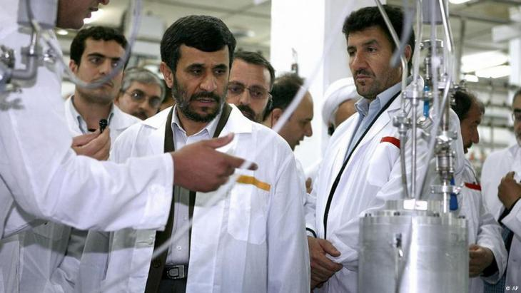 Former Iranian President Mahmoud Ahmadinejad, centre, listens to a technician during his visit to the Natanz Uranium Enrichment Facility some 322 kilometres south of the Iranian capital Tehran on April 8, 2008 (photo: AP)