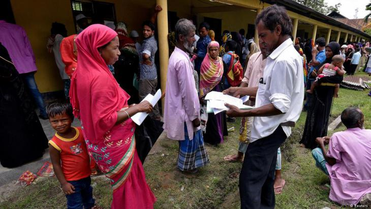 Villagers in Assam submit their documents for verification (photo: Reuters)