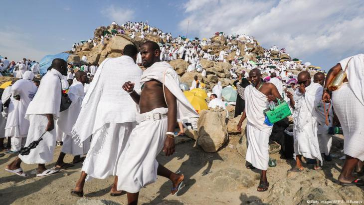 Muslim pilgrims gather on Mount Arafat, also known as Jabal al-Rahma or the ʹMount of Mercyʹ, southeast of the Saudi holy city of Mecca, on Arafat Day which is the climax of the Hajj pilgrimage early on 20 August 2018 (photo: AHMAD AL-RUBAYE/AFP/Getty Images)