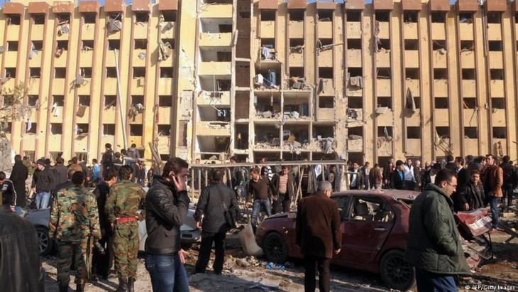 Syrians gather at the scene of an explosion outside Aleppo University, between the university dormitories and the architecture faculty, on 15 January 2013 (photo: AFP/Getty Images)