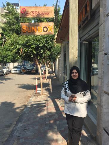 Sun Box entrepreneur Majd Mashharawi in front of her office/shop premises in Gaza City (photo: Inge Gunther)