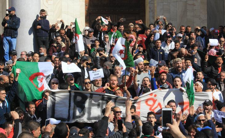 Algerian demonstrators march close to the Grande Poste in downtown Algiers (photo: Sofian Philip Naceur)