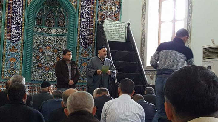 Sociologist Javid Shahmaliyev stands next to the imam during an awareness session held in a local mosque (photo: private)