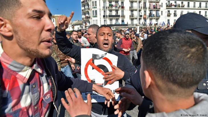 Algerian protestors demonstrate against their president's candidacy for a fifth term, on 22 February 2019 in Algiers (photo: Getty Images/R. Kramdi)