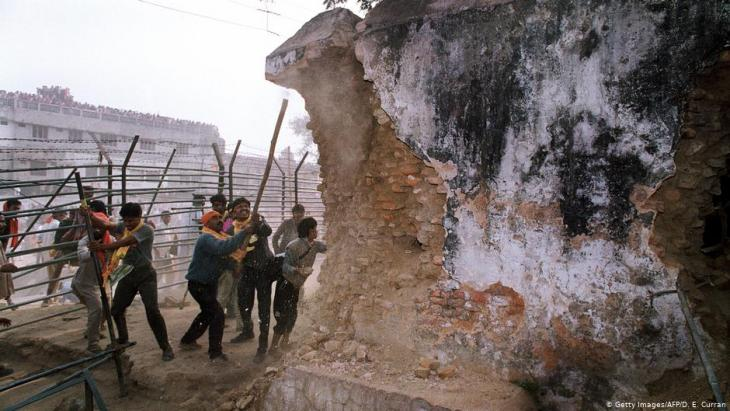 Radical Hindus destroying the Babri Mosque in Ayodhya on 6 December 1992 (photo: Getty Images/AFP/D. E. Curran)