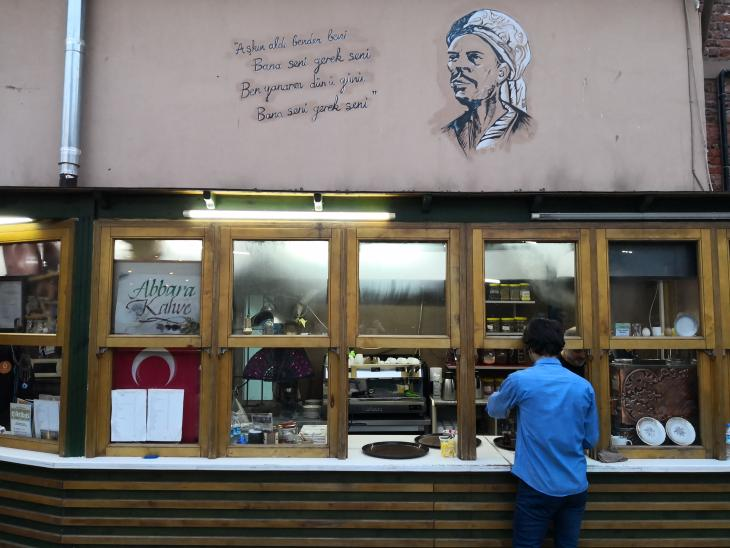 The likeness of Yunus Emre and two famous lines of his poetry adorn the wall of a teahouse in the Uskudar district of Istanbul