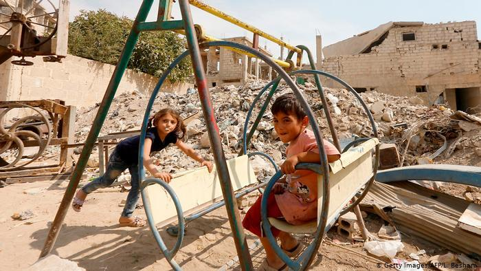 Children at play in Zabdin, Ghouta, Syria (photo: Getty Images/AFP/L. Beshara)