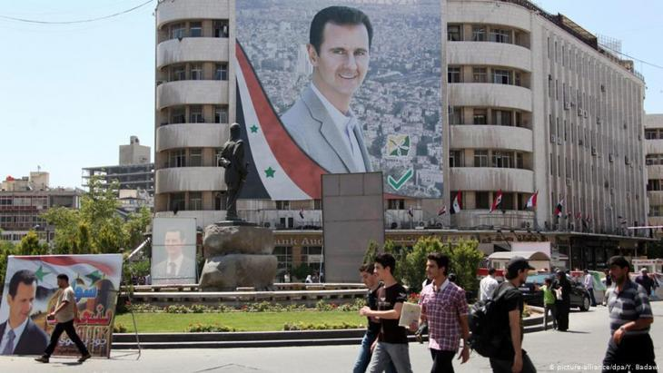 Portrait of Bashar al-Assad on Al-Mohafazah Square in Damascus (photo: dpa/picture-alliance)