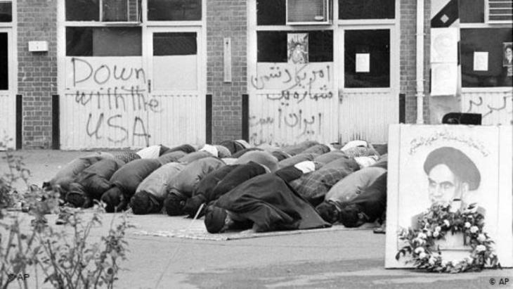Iranian students pray inside the American Embassy compound before anti-American slogans on the third day of the occupation of the embassy in Tehran, Iran on 6 November 1979 (photo: AP)