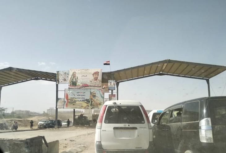 A checkpoint leading into the city. The large billboards remember those killed while fighting the Houthis (photo: Ahmed Nagi)