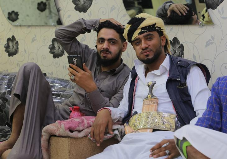 Yemeni men chewing khat (a stimulant like coca) at a local barbershop (photo: Ahmed Nagi)
