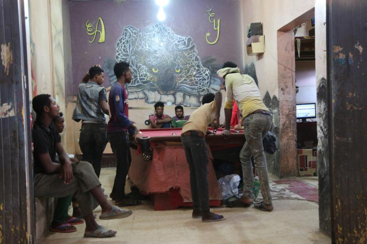African migrants playing pool in a games and Internet cafe (photo: Ahmed Nagis)