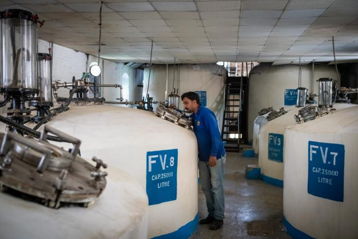 An engineer monitors the tanks used for beer-making at the Murree Brewery (photo: Philipp Breu)