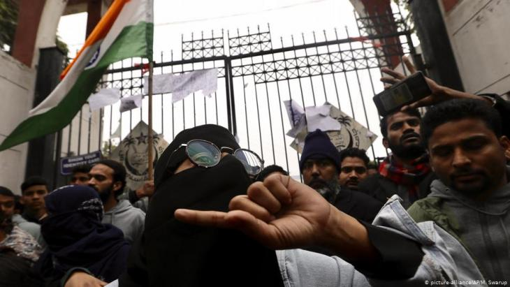 Indian students at Jamia Millia Islamia University shout slogans during a protest in New Delhi, India, on 16 December 2019 (photo: AP/Manish Swarup)