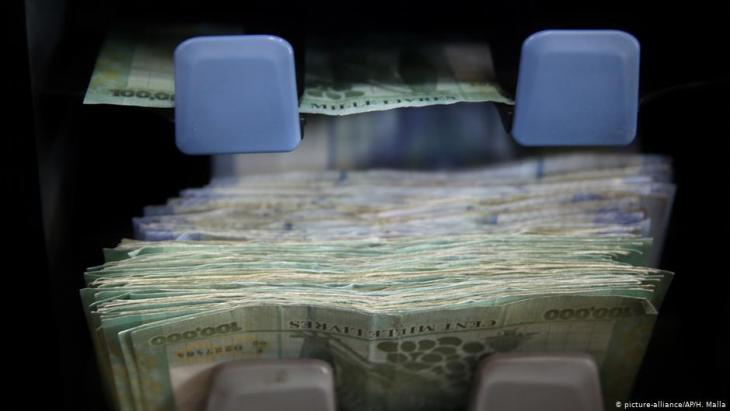 Lebanese currency is counted on a machine at a currency exchange shop in Beirut, Lebanon (photo: AP Photo/Hussein Malla)