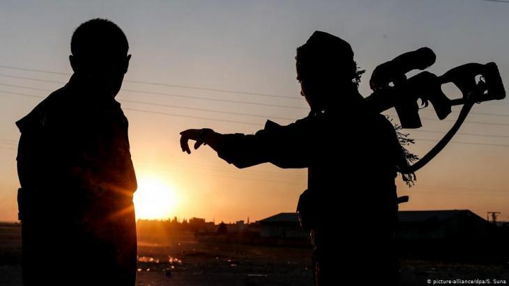 Symbolic image of Kurdish militiamen (photo: picture-alliance/dpa/S. Suna)