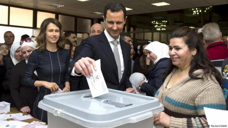 Syria's ruler, Bashar al-Assad, casts his vote during 2016 parliamentary elections, with his wife Asma on his left (photo: Reuters/SANA)