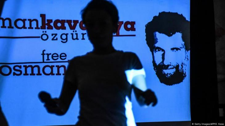 Solidarity with Osman Kavala – poster at a press conference given by his lawyers in October 2018 (photo: AFP/Getty Images)