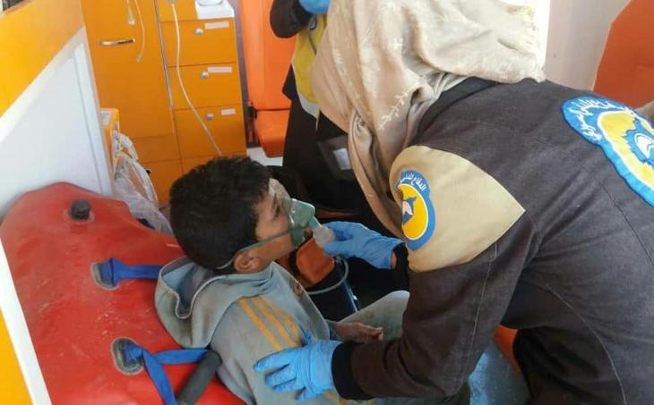 Female member of the White Helmets provides medical aid to a civilian (photo: Syria Civil Defence)