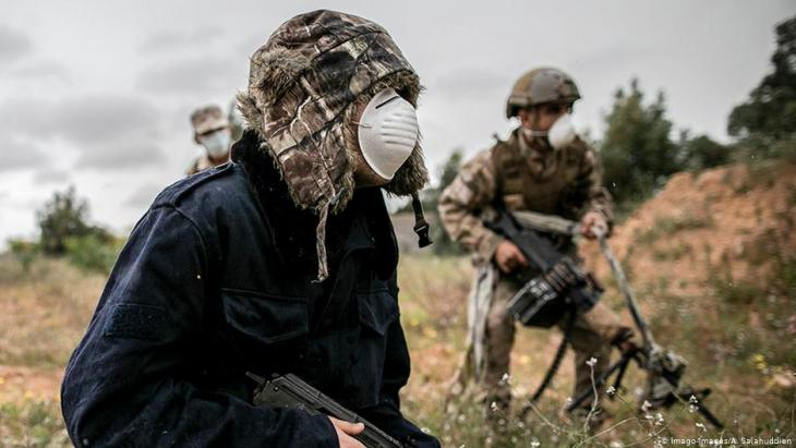 Mask-wearing GNA fighters in Libya (photo: Imago-Images/A. Salahuddien)
