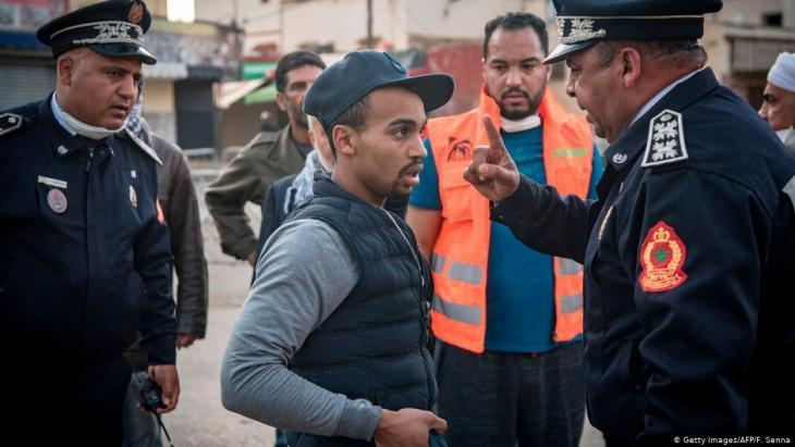 Moroccan police in Rabat instructing a resident in the capital to return home on 27 March 2020 (photo: Getty Images/AFP)