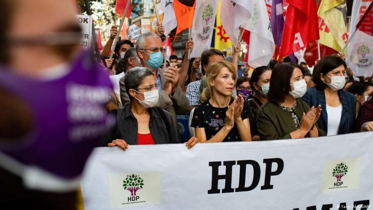 Protesters holding a HDP banner and flags during a march in Istanbul (photo: Yasin Akgul/AFP)
