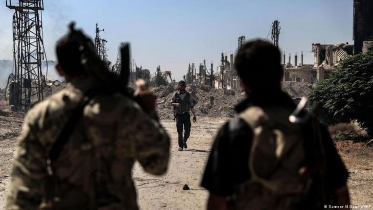 Fighters belonging to Jaish al-Islam in Douma (photo: Sameer Al-Doumy/AFP)