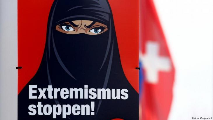 Poster urging Swiss voters to approve a ban on full-face veils in a recent referendum (photo: Arnd Wiegmann)