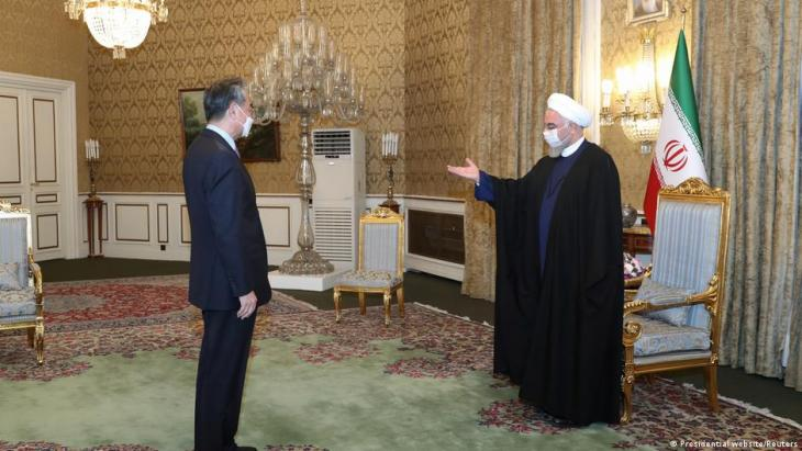Chinese Foreign Minister Wang Yi (left) and Iranian President Hassan Rouhani, Tehran, March 2021 (photo: Presidential Website/Reuters)