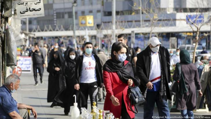 People walking along a street in Tehran, 16 February 2021 (photo: Fatemeh Bahrami/Anadolu Agency)